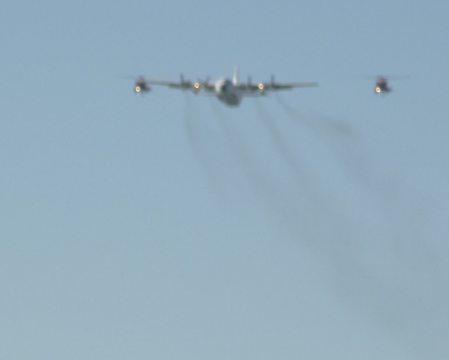 The service started with a fly-over by a Coast Guard plane and two CG helicopters