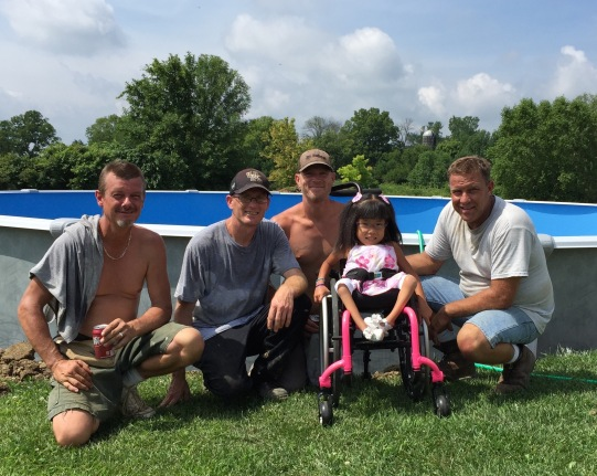 Lilyan meeting the pool installers who worked in the heat to get her pool up
