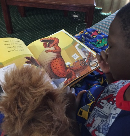 Reading one of his new books to his lion