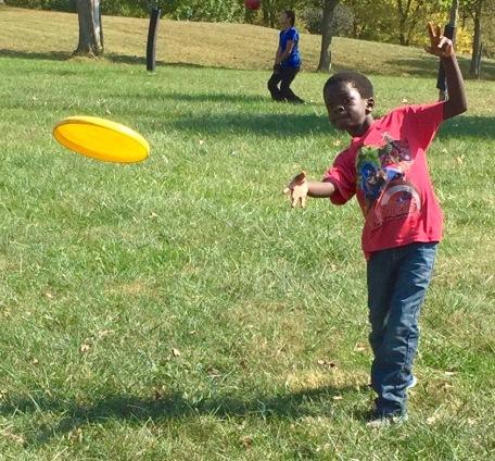 Nolan's mastering the Frisbee throw