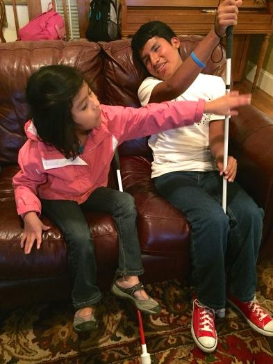 Colin and Adriana comparing their canes. A precious moment.