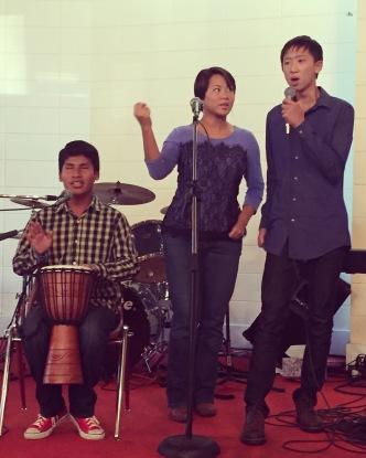 Three of the kids warming up before singing at Kingdom Life